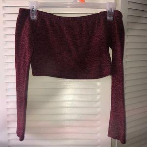 Maroon long-sleeved crop top & mini skirt set.